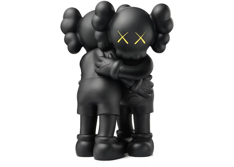 dwie przytulone czarne figurki zżółtymi oczami wkształcie X