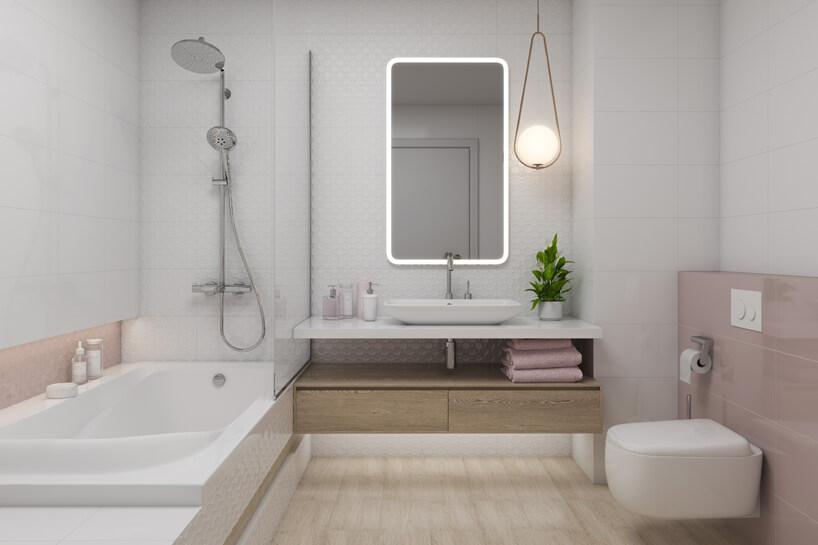 jasna łazienka zróżowymi akcentami ikwadratowym lustrem idużą wanną