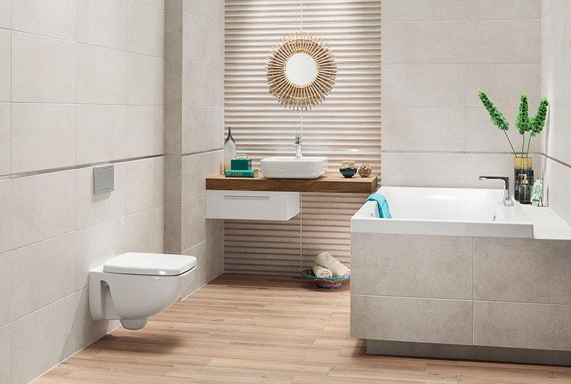 skromna łazienka zwanną wdelikatnych szarościach