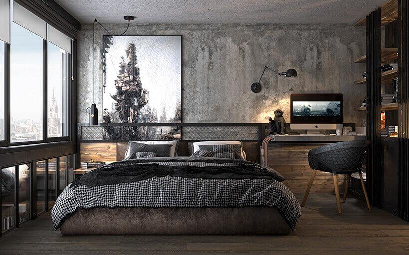 sypialnia wszarych betonowych kolorach zniskim dużym łóżkiem oraz ciepłymi drewnianymi dodatkami