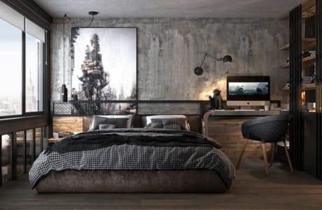 sypialnia w szarych betonowych kolorach z niskim dużym łóżkiem oraz ciepłymi drewnianymi dodatkami