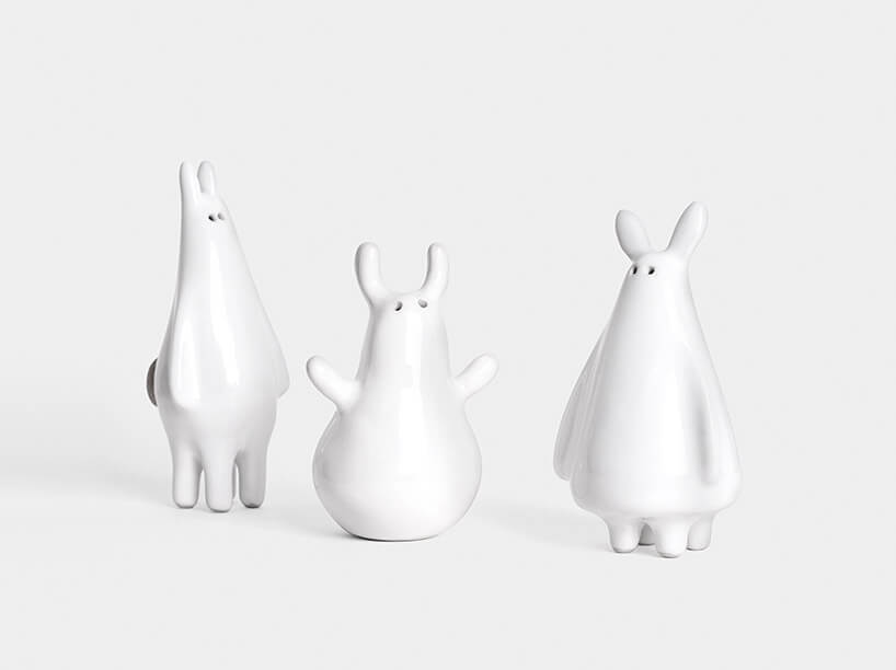 trzy białe solniczki ipieprzniczki wformie bajkowych stworów