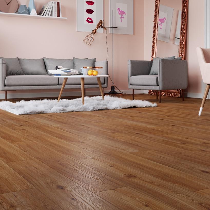 szary zestaw mebli sofa ifotel na drewnianej jasno brązowej podłodze