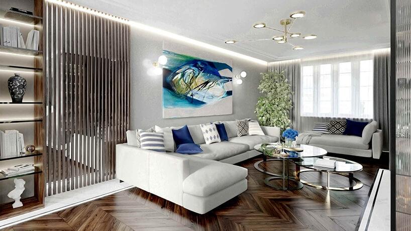 elegancki jasny salon zciemną drewnianą podłogą zdużą narożną sofą
