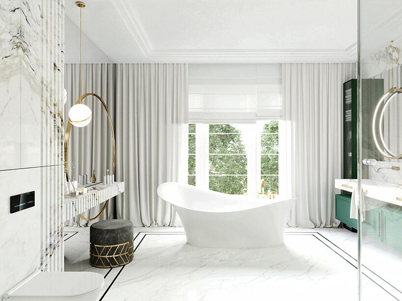 białą łazienka zbiałą kamienną podłogą iwolnostojącą wanną inieregularnej krawędzi