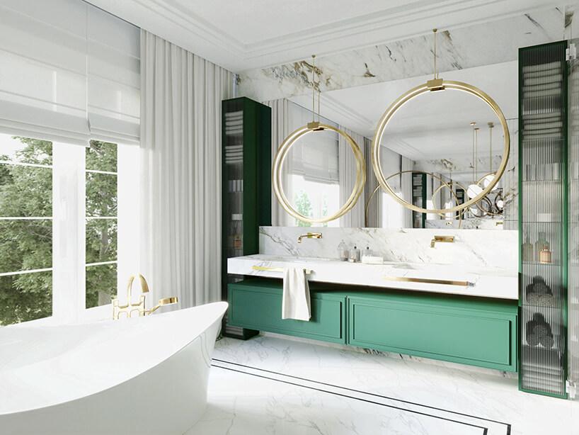 elegancka biała łazienka zdwoma umywalkami wbiałym kamieniu ze złotymi dodatkami