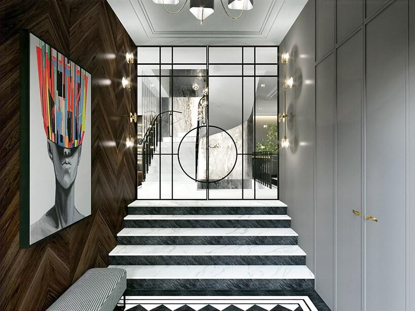 elegancki wejście zbiało czarnymi schodami zbiałą zabudową po jednej stronie idrewnianym wykończeniem ściany