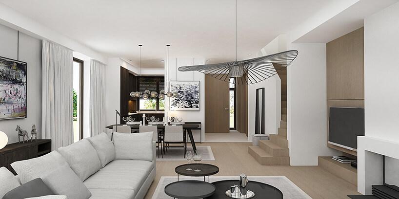 styl minimalistyczny wbiałym wnętrzu salonu połączonym zkuchnią
