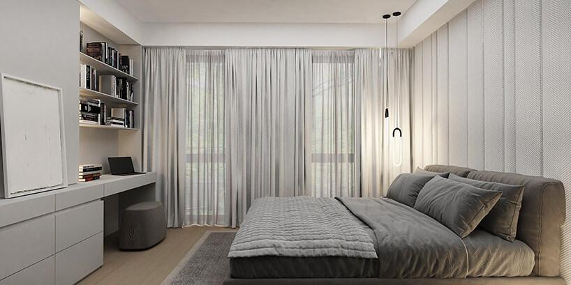 duże szare łózko wdużej sypialni wstylu minimalistycznym
