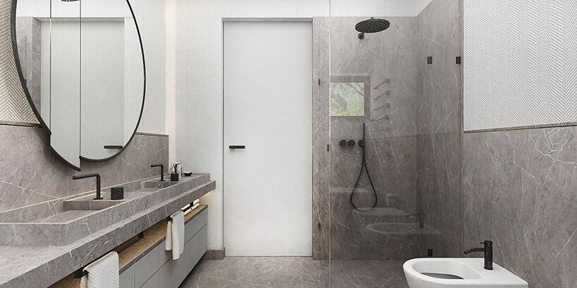 styl minimalistyczny wszarej łazience zbiałym dzrzwiami