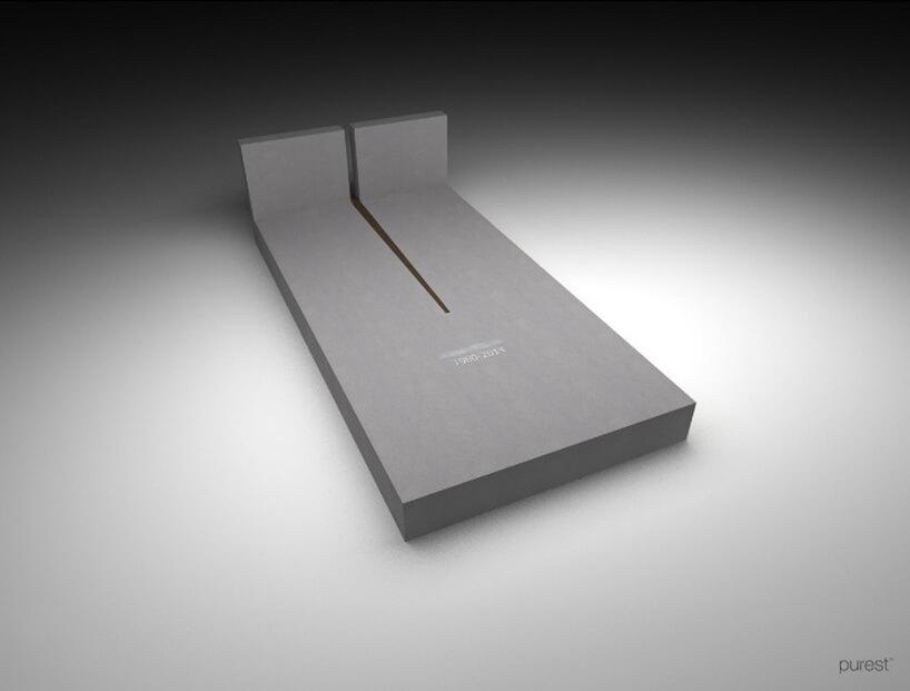 szary pomnik zminimalistycznym rozcięciem płyty