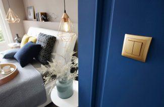 złoty włącznik na niebieskiej ścianie