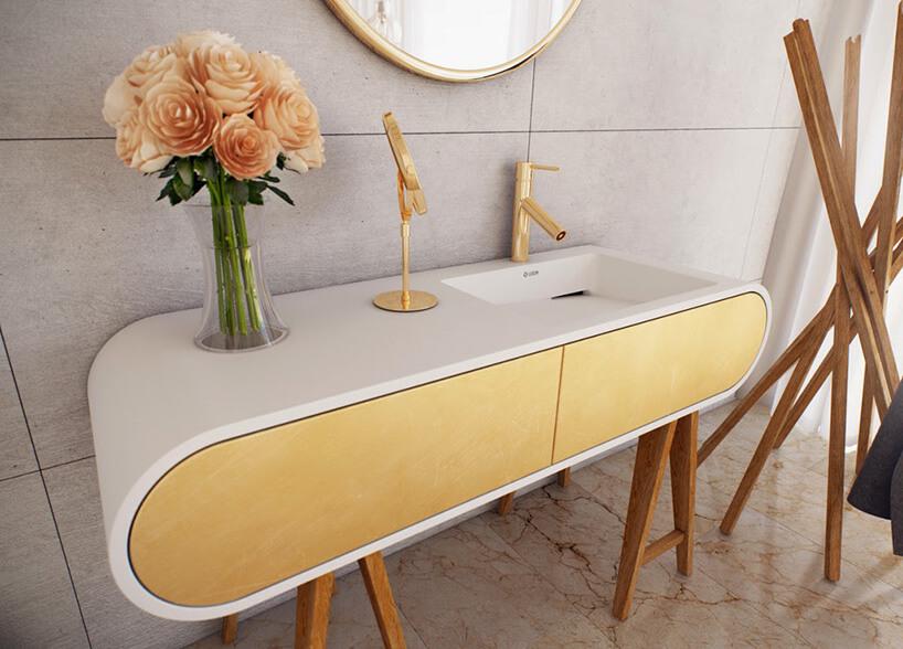 ładna szafka łazienkowa ze złotymi elementami