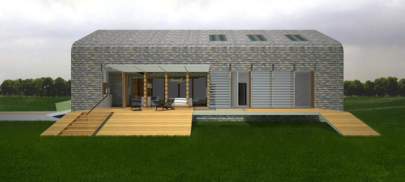 nowoczesny duży taras zszaro zielonym domem