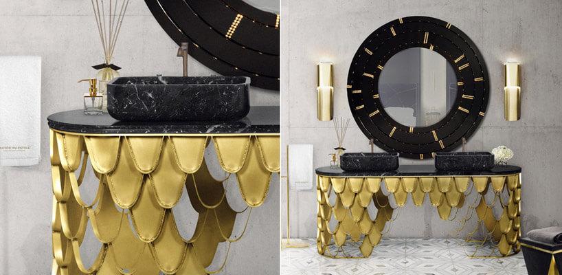 szafka ze złotymi elementami pod dużym czarnym lustrem